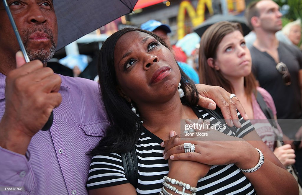 Antoinette Thompson and her husband Freddy Walters from Rochester, New York watch a giant screen in Times Square as President Obama speaks on the 50th anniversary of Martin Luther King Jr.'s 'I Have a Dream' speech on August 28, 2013 in New York City. With the official ceremony in Washington D.C., a crowd gathered in Manhattan's Times Square to watch the President's speech broadcast live and commemorate the anniversary of one of the most important days in the history of the American civil rights movement.