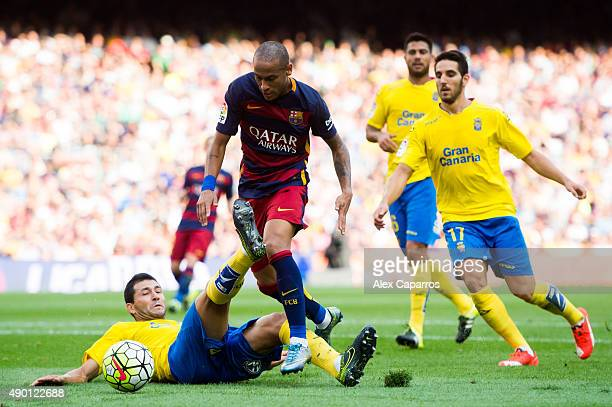 Antolin Alcaraz of UD Las Palmas tackles Neymar Santos Jr of FC Barcelona during the La Liga match between FC Barcelona and UD Las Palmas at Camp Nou...