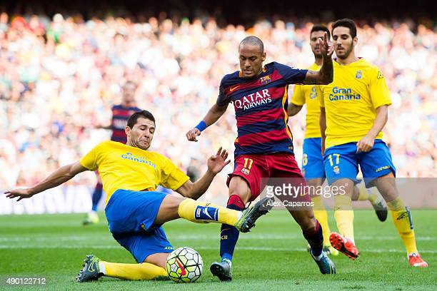 Antolin Alcaraz of UD Las Palmas tackles Neymar Santos Jr of FC Barcelona during the La Liga match between FC Barcelona and UD Las Palmas at Camp Nou...