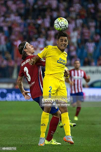 Antolin Alcaraz of UD Las Palmas wins the header after Filipe Luis of Atletico de Madrid during the La Liga match between Club Atletico de Madrid and...