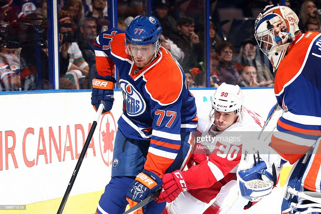 <a gi-track='captionPersonalityLinkClicked' href=/galleries/search?phrase=Anton+Belov&family=editorial&specificpeople=4628750 ng-click='$event.stopPropagation()'>Anton Belov</a> #77 of the Edmonton Oilers battles for the puck against Stephen Weiss #90 of the Detroit Red Wings on November 2, 2013 at Rexall Place in Edmonton, Alberta, Canada.