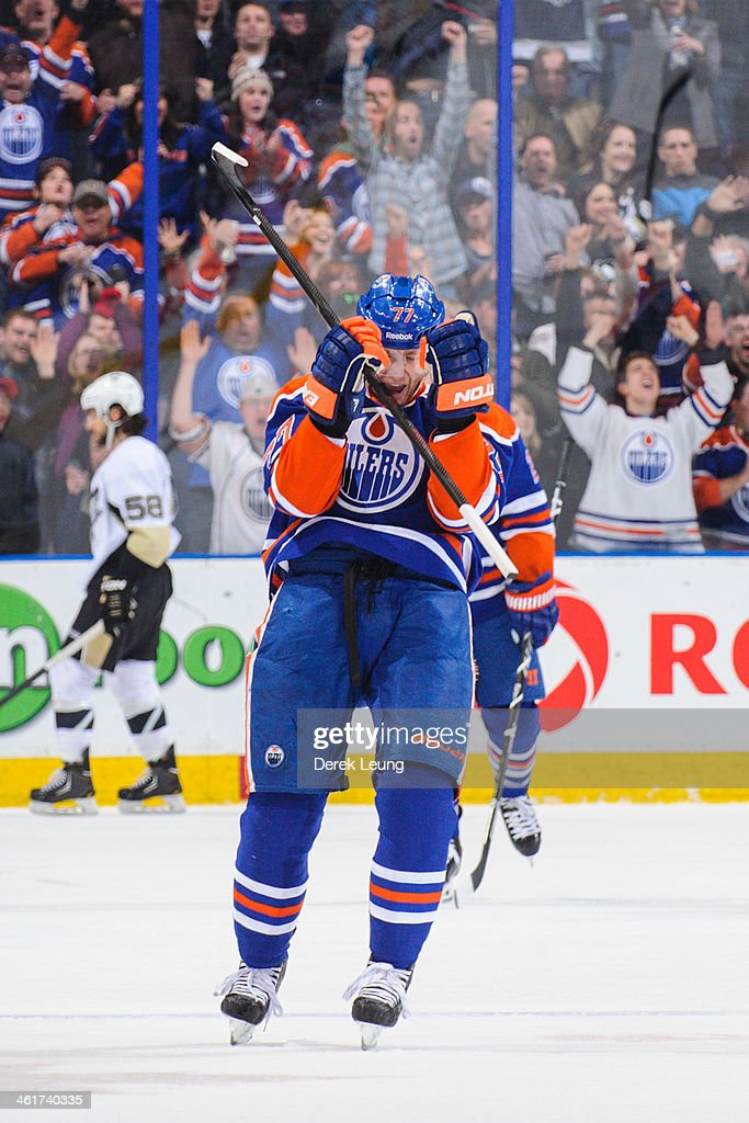 <a gi-track='captionPersonalityLinkClicked' href=/galleries/search?phrase=Anton+Belov&family=editorial&specificpeople=4628750 ng-click='$event.stopPropagation()'>Anton Belov</a> #77 of the Edmonton Oilers celebrates after scoring his first NHL goal during a game against the Pittsburgh Penguins at Rexall Place on January 10, 2014 in Edmonton, Alberta, Canada. The Oilers won 4-3 in overtime.