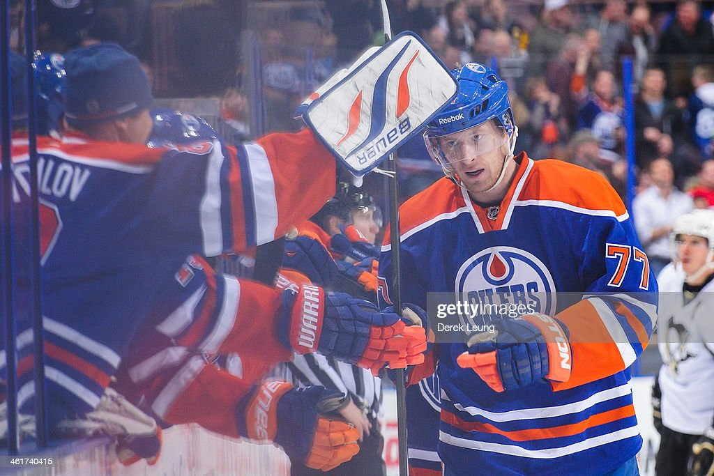 <a gi-track='captionPersonalityLinkClicked' href=/galleries/search?phrase=Anton+Belov&family=editorial&specificpeople=4628750 ng-click='$event.stopPropagation()'>Anton Belov</a> #77 of the Edmonton Oilers celebrates with the bench after scoring his first NHL goal to tie the gameagainst the Pittsburgh Penguins during an NHL game at Rexall Place on January 10, 2014 in Edmonton, Alberta, Canada. The Oilers won 4-3 in overtime.