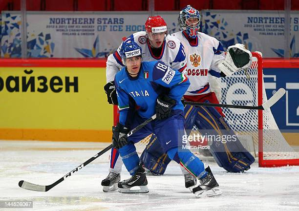 Anton Bernard of Italy battles for position with Yevgeni Malkin of Russia Russia during the IIHF World Championship group S match between Italy and...