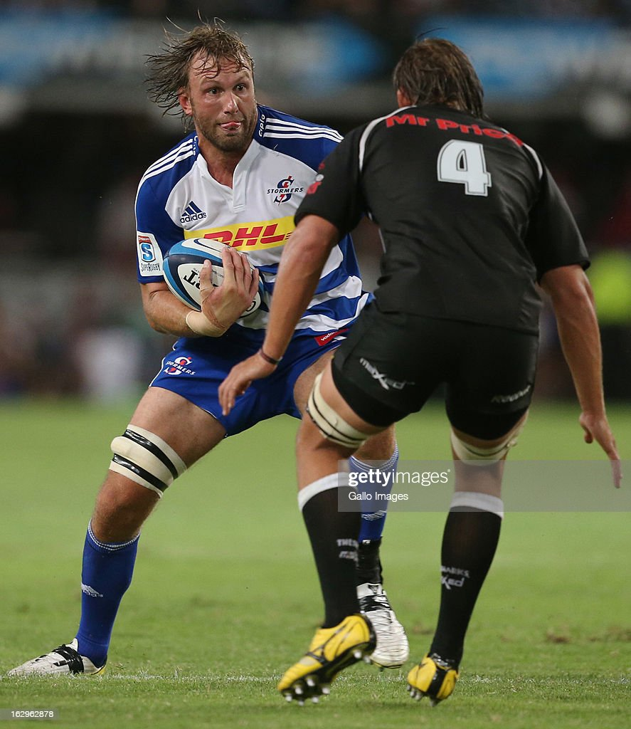 AFRICA - MARCH 02, Anton Bresler looks to tackle Andries Bekker during the Super Rugby match between The Sharks and DHL Stormers at Kings Park on March 02, 2013 in Durban, South Africa.
