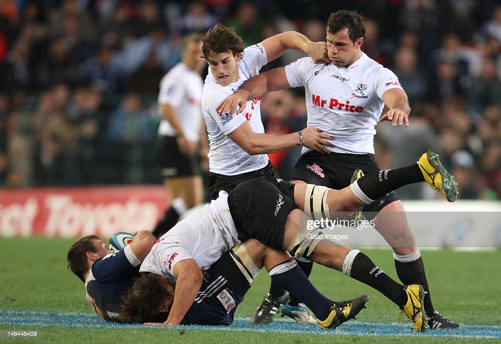 Anton Bresler of Sharks tackles Rynhardt Elstadt during the Super Rugby semi final match between DHL Stormers and The Sharks from DHL Newlands Stadium on July 28, 2012 in Cape Town, South Africa.