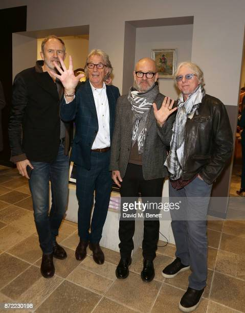 Anton Corbijn Paul Smith Michael Stipe and Mike Mills attend the launch of the Paul Smith x REM collection celebrating the 25th anniversary of REM's...