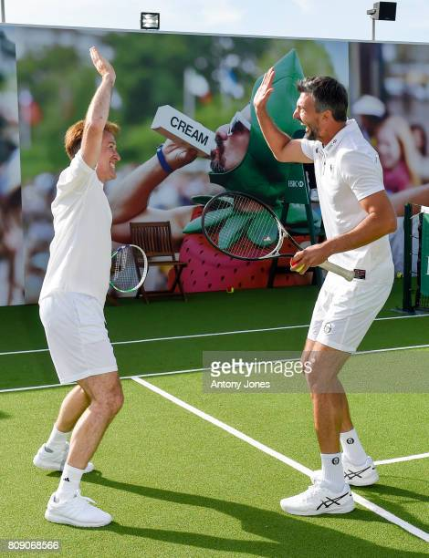 Anton du Beke and Goran Ivanisevic pose for pictures during a tennis lesson to promote HSBC's sponsorship of Wimbledon on HSBC Court 20 at the All...