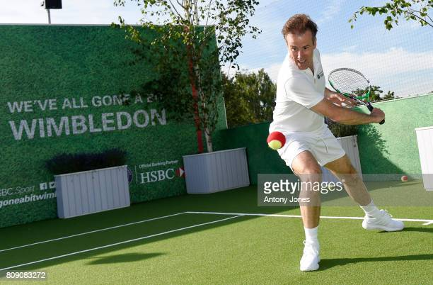 Anton du Beke pose for pictures during a tennis lesson to promote HSBC's sponsorship of Wimbledon on HSBC Court 20 at the All England Lawn Tennis and...