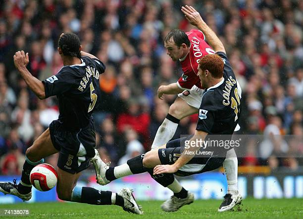 Anton Ferdinand and James Collins of West Ham United stretch to block the shot of Wayne Rooney of Manchester United during the Barclays Premiership...
