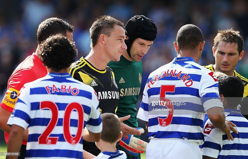 <a gi-track='captionPersonalityLinkClicked' href=/galleries/search?phrase=Anton+Ferdinand&family=editorial&specificpeople=542862 ng-click='$event.stopPropagation()'>Anton Ferdinand</a> of Queens Park Rangers walks past <a gi-track='captionPersonalityLinkClicked' href=/galleries/search?phrase=John+Terry&family=editorial&specificpeople=171535 ng-click='$event.stopPropagation()'>John Terry</a> of Chelsea prior to the Barclays Premier League match between Queens Park Rangers and Chelsea at Loftus Road on September 15, 2012 in London, England.