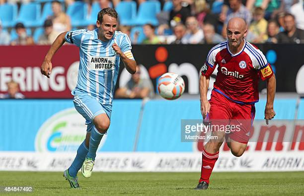 Anton Fink of Chemnitz battles for the ball with Patrick Herrmann of Kiel during the third league match between Chemnitzer FC and Holstein Kiel at...