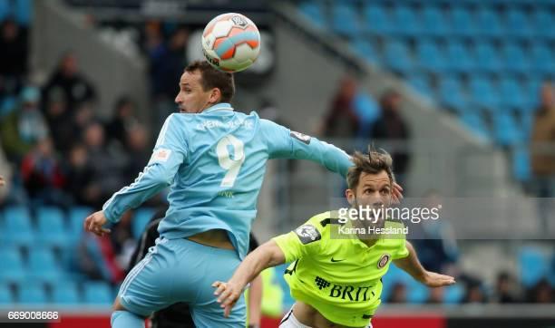 Anton Fink of Chemnitz challenges Patrick Mayer of Wiesbaden during the Third League Match between Chemnitzer FC and SV Wehen Wiesbaden on April 15...