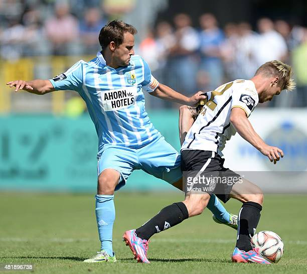 Anton Fink of Chemnitz competes with Dennis Chessa of Aalen for the ball during the Third League match between VfR Aalen and Chemnitzer FC at...