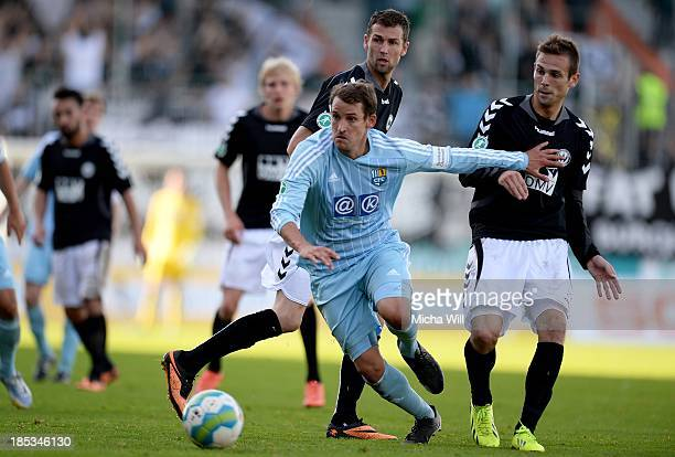 Anton Fink of Chemnitz fights with two opponents for the ball during the Third League match between Wacker Burghausen and Chemnitzer FC at...