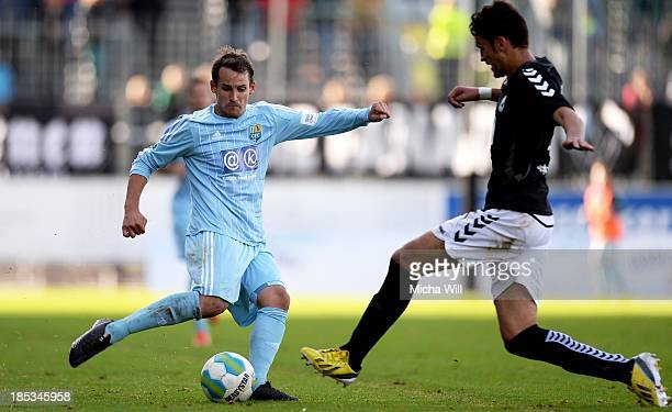 Anton Fink of Chemnitz is challenged by Jure Colak of Burghausen during the Third League match between Wacker Burghausen and Chemnitzer FC at...