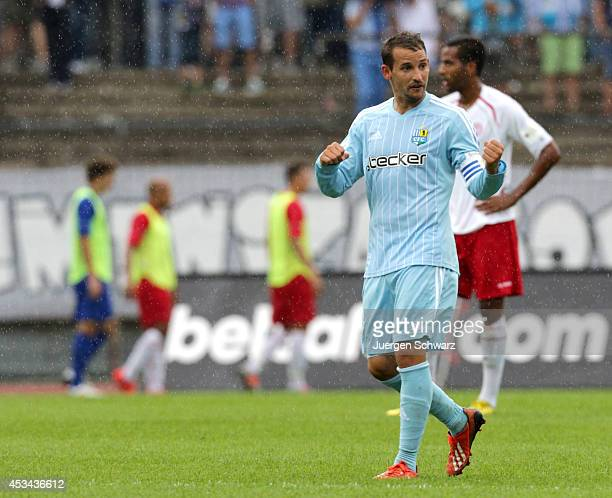 Anton Fink of Chemnitz lifts his fists after scoring during the Third Bundesliga match between Fortuna Koeln and Chemnitzer FC at Suedstadion on...