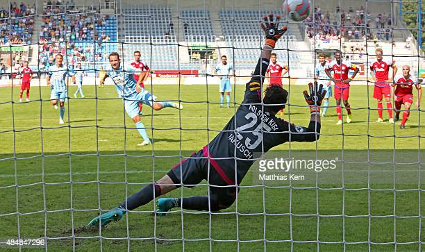 Anton Fink scores the fourth goal after penalty during the third league match between Chemnitzer FC and Holstein Kiel at Stadion an der...