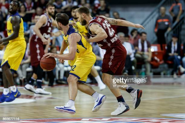 Anton Gavel of Bayern Muenchen and Mickey McConnell of Oldenburg battle for the ball during the easyCredit BBL Basketball Bundesliga match between FC...