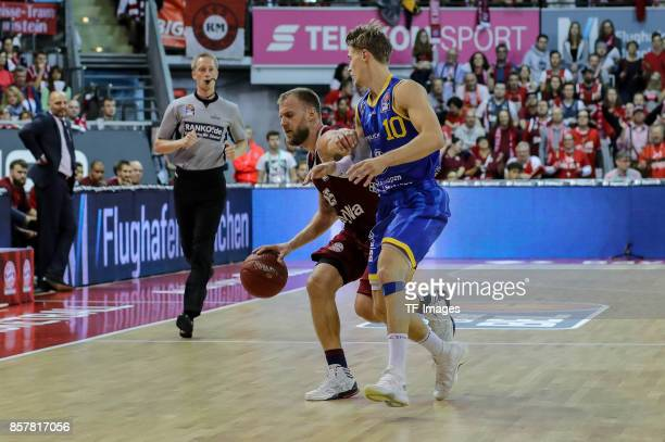 Anton Gavel of Bayern Muenchen and Thomas Klepeisz of Braunschweig battle for the ball during the easyCredit BBL Basketball Bundesliga match between...