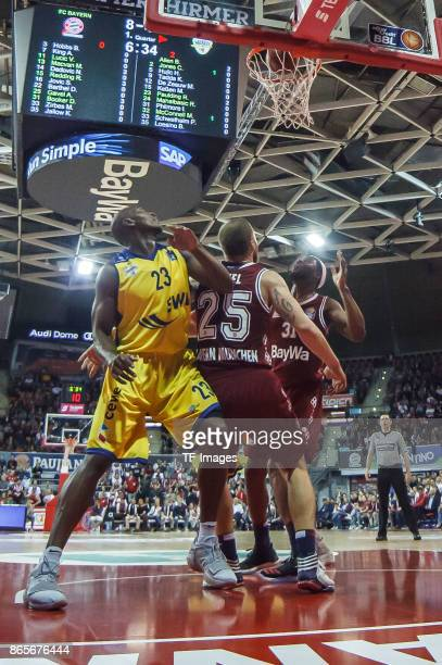 Anton Gavel of Bayern Muenchen Devin Booker of Bayern Muenchen and Rickey Paulding of Oldenburg battle for the ball during the easyCredit BBL...