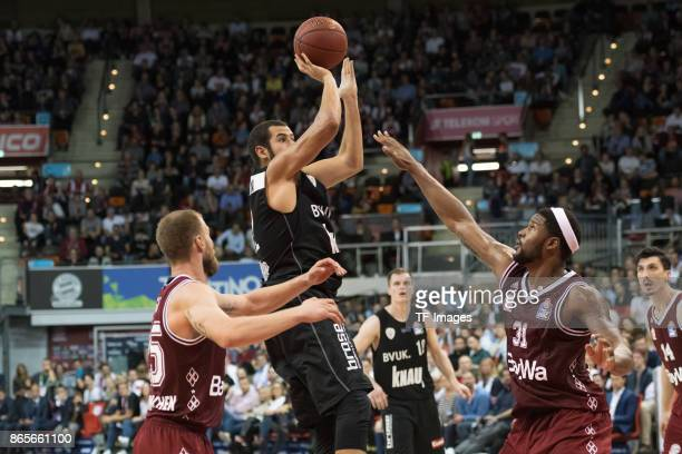 Anton Gavel of Bayern Muenchen Ryan Anderson of Wuerzburg and Devin Booker of Bayern Muenchen battle for the ball during the easyCredit BBL...