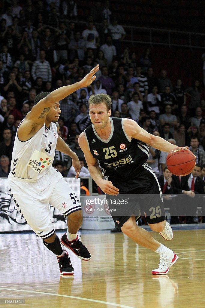 Anton Gavel of Brose Baskets Bamberg competes with #55 Curtis Jerrells during the 2012-2013 Turkish Airlines Euroleague Regular Season Game Day 7 between Besiktas JK Istanbul v Brose Baskets Bamberg at Abdi Ipekci Arena on November 23, 2012 in Istanbul, Turkey.