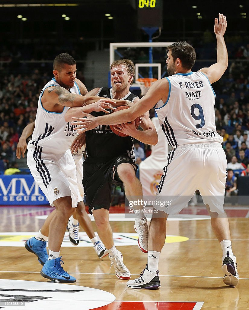 Anton Gavel #25 of Brose Baskets duels for the ball with <a gi-track='captionPersonalityLinkClicked' href=/galleries/search?phrase=Felipe+Reyes&family=editorial&specificpeople=732755 ng-click='$event.stopPropagation()'>Felipe Reyes</a> #9 and Rafael Hettsheimeir #15 of Real Madrid during the Turkish Airlines Euroleague Top 16 game at Palacio de los Deportes on February 28, 2013 in Madrid, Spain.