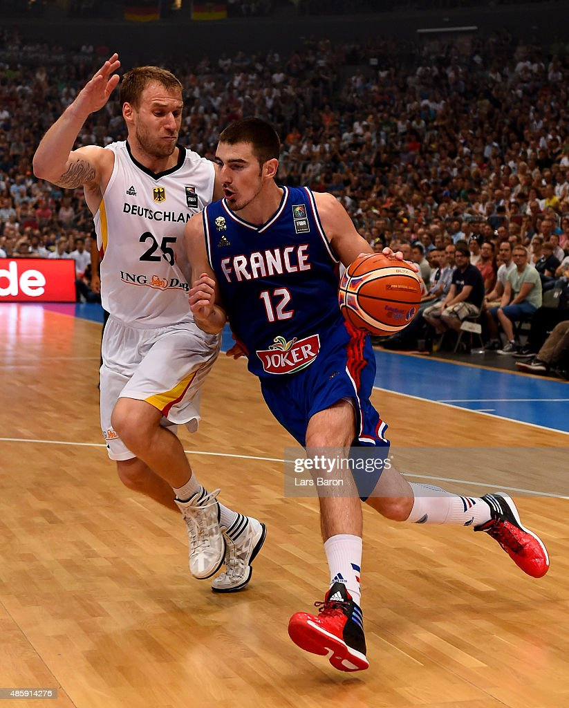 Anton Gavel of Germany challenges Nando de Colo of Franceduring the Men's Basketball friendly match between Germany and France at Lanxess Arena on...