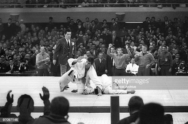 Anton Geesink of Netherlands celebrates after beating Akio Kaminaga of Japan compete in the Judo Openweight Final during the Tokyo Olympic at Nippon...