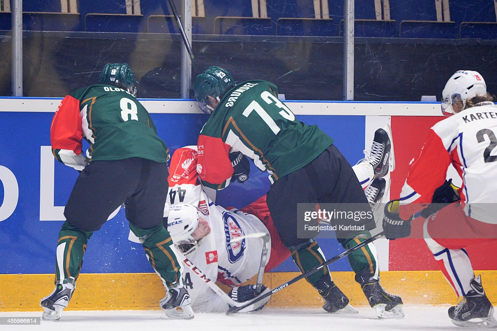Anton Grundel #73 of Faerjestad Karlstad tackels <a gi-track='captionPersonalityLinkClicked' href=/galleries/search?phrase=Morten+Ask&family=editorial&specificpeople=742016 ng-click='$event.stopPropagation()'>Morten Ask</a> #44 of Valerenga Oslo during the Champions Hockey League group stage game between Faerjestad Karlstadt and Valerenga Oslo on September 23, 2014 in Karlstad, Sweden.