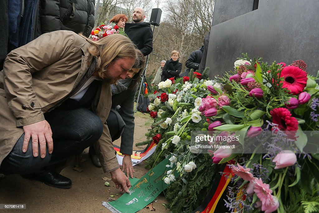 <a gi-track='captionPersonalityLinkClicked' href=/galleries/search?phrase=Anton+Hofreiter&family=editorial&specificpeople=11451109 ng-click='$event.stopPropagation()'>Anton Hofreiter</a>, German partyleader Greens Party (Buendnis 90/Die Gruenen) and <a gi-track='captionPersonalityLinkClicked' href=/galleries/search?phrase=Katrin+Goering-Eckardt&family=editorial&specificpeople=5335700 ng-click='$event.stopPropagation()'>Katrin Goering-Eckardt</a>, German Greens Party (Buendnis 90/Die Gruenen) co-faction leader lay down a wreath at a Holocaust memorial during an event to commemorate the homosexual men and women persecuted by the Nazis during the Holocaust on January 27, 2016 in Berlin, Germany. Thousands of people will come together today to remember and honour the millions killed in the Holocaust and mark the for the 71th anniversary of the liberation of Auschwitz by Soviet troops on 27th January, 1945.