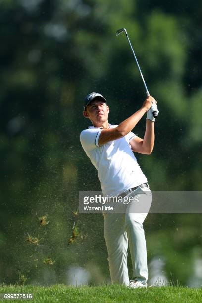 Anton Karlsson of Sweden hits his second shot on the 10th hole during day one of the BMW International Open at Golfclub Munchen Eichenried on June 22...