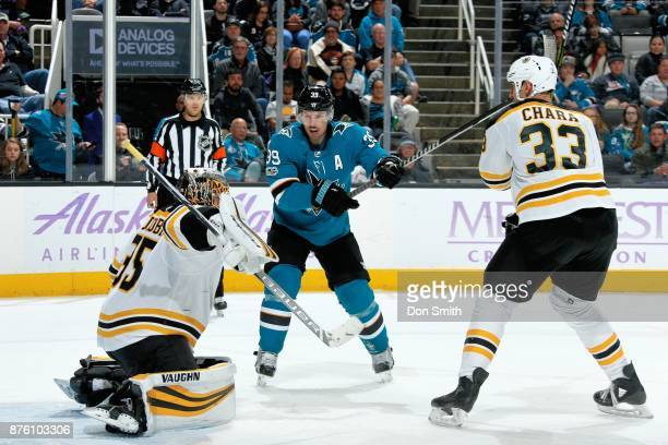 Anton Khudobin and Zdeno Chara of the Boston Bruins defend Logan Couture of the San Jose Sharks at SAP Center on November 18 2017 in San Jose...