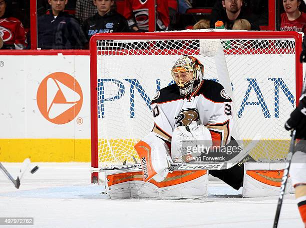 Anton Khudobin of the Anaheim Ducks deflects the puck and goes down in the crease to protect on the rebound during a NHL game against the Carolina...