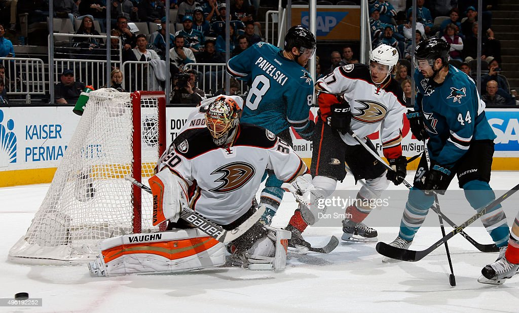 Anton Khudobin of the Anaheim Ducks makes another save with Joe Pavelski and MarcEdouard Vlasic of the San Jose Sharks and Hampus Lindholm standing...