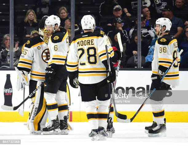 Anton Khudobin of the Boston Bruins celebrates a 41 win over the Los Angeles Kings with Colin Miller at Staples Center on February 23 2017 in Los...