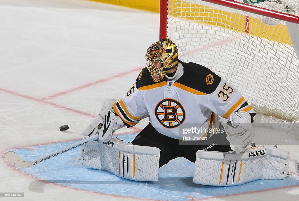 <a gi-track='captionPersonalityLinkClicked' href=/galleries/search?phrase=Anton+Khudobin&family=editorial&specificpeople=722106 ng-click='$event.stopPropagation()'>Anton Khudobin</a> #35 of the Boston Bruins deflects the puck against the Buffalo Sabres at First Niagara Center on March 31, 2013 in Buffalo, New York. Boston won 2-0.
