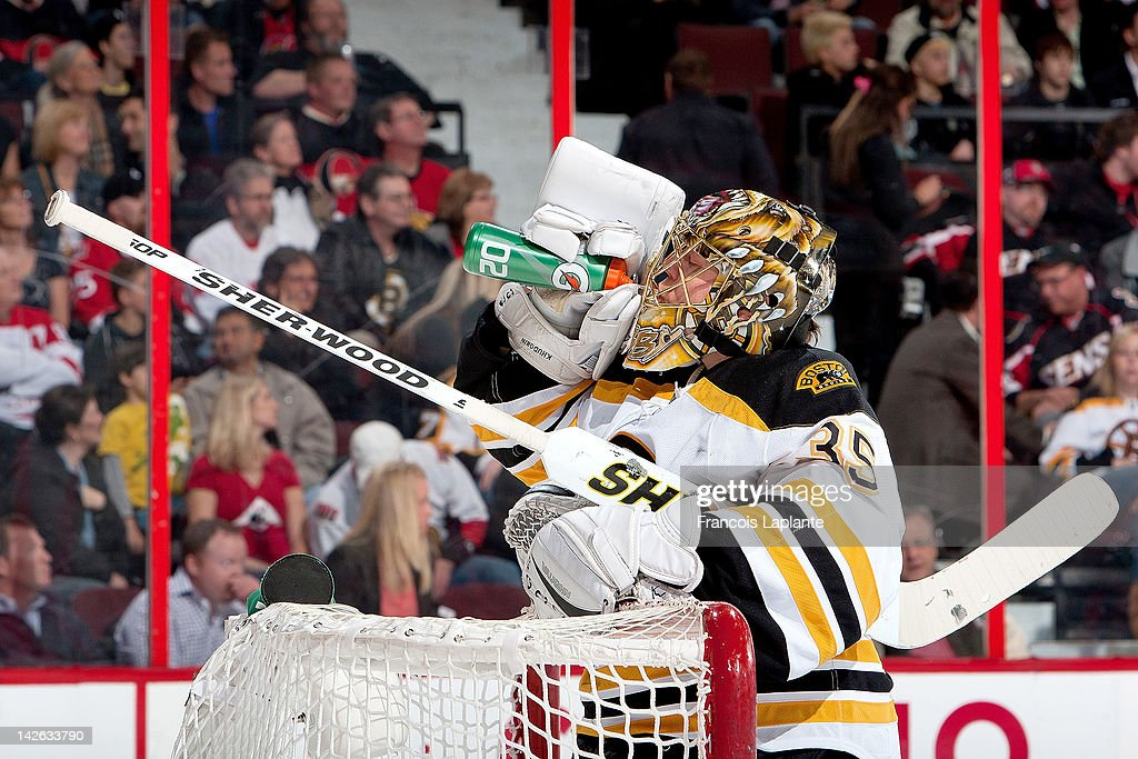 Anton Khudobin #35 of the Boston Bruins drinks for his water bottle during a stop of play against the Ottawa Senators at Scotiabank Place on April 5, 2012 in Ottawa, Ontario, Canada.