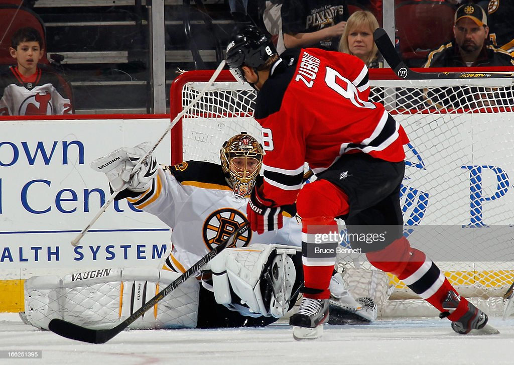 <a gi-track='captionPersonalityLinkClicked' href=/galleries/search?phrase=Anton+Khudobin&family=editorial&specificpeople=722106 ng-click='$event.stopPropagation()'>Anton Khudobin</a> #35 of the Boston Bruins gets in position to make the save on <a gi-track='captionPersonalityLinkClicked' href=/galleries/search?phrase=Dainius+Zubrus&family=editorial&specificpeople=204779 ng-click='$event.stopPropagation()'>Dainius Zubrus</a> #8 of the New Jersey Devils at the Prudential Center on April 10, 2013 in Newark, New Jersey. The Bruins defeated the Devils 5-4.
