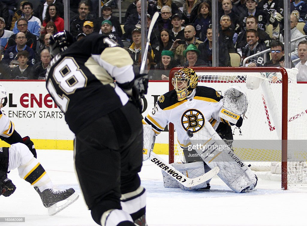 <a gi-track='captionPersonalityLinkClicked' href=/galleries/search?phrase=Anton+Khudobin&family=editorial&specificpeople=722106 ng-click='$event.stopPropagation()'>Anton Khudobin</a> #35 of the Boston Bruins make a save on <a gi-track='captionPersonalityLinkClicked' href=/galleries/search?phrase=James+Neal&family=editorial&specificpeople=1487991 ng-click='$event.stopPropagation()'>James Neal</a> #18 of the Pittsburgh Penguins during the game at Consol Energy Center on March 12, 2013 in Pittsburgh, Pennsylvania. The Penguins won 3-2.