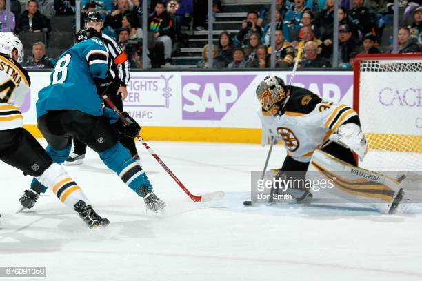 Anton Khudobin of the Boston Bruins makes a save against Tomas Hertl of the San Jose Sharks at SAP Center on November 18 2017 in San Jose California