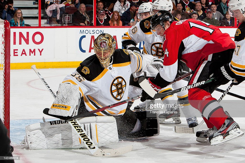 <a gi-track='captionPersonalityLinkClicked' href=/galleries/search?phrase=Anton+Khudobin&family=editorial&specificpeople=722106 ng-click='$event.stopPropagation()'>Anton Khudobin</a> #35 of the Boston Bruins makes a save as <a gi-track='captionPersonalityLinkClicked' href=/galleries/search?phrase=Colin+Greening&family=editorial&specificpeople=7183741 ng-click='$event.stopPropagation()'>Colin Greening</a> #14 of the Ottawa Senators looks for a rebound at Scotiabank Place on April 5, 2012 in Ottawa, Ontario, Canada.