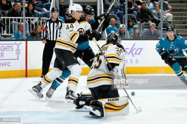 Anton Khudobin of the Boston Bruins protects the net as Rob O'Gara of the Boston Bruins defends Timo Meier of the San Jose Sharks at SAP Center on...