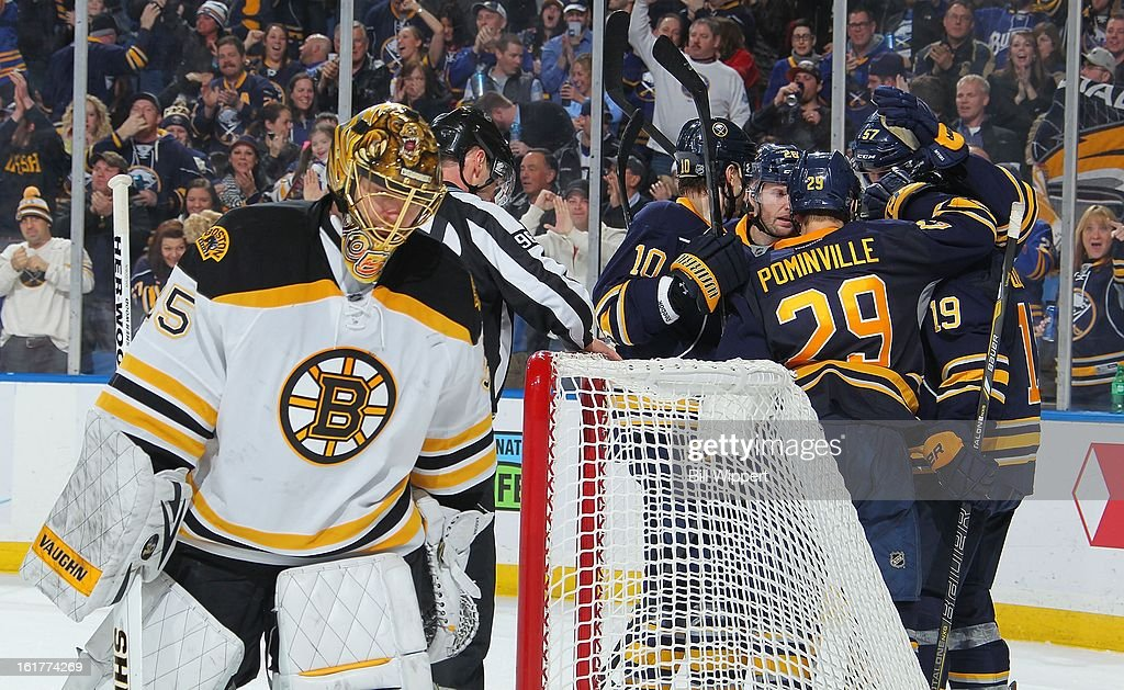 <a gi-track='captionPersonalityLinkClicked' href=/galleries/search?phrase=Anton+Khudobin&family=editorial&specificpeople=722106 ng-click='$event.stopPropagation()'>Anton Khudobin</a> #35 of the Boston Bruins skates away while <a gi-track='captionPersonalityLinkClicked' href=/galleries/search?phrase=Cody+Hodgson&family=editorial&specificpeople=4151192 ng-click='$event.stopPropagation()'>Cody Hodgson</a> #19 of the Buffalo Sabres celebrates with teammates after scoring a third period goal on February 15, 2013 at the First Niagara Center in Buffalo, New York. Buffalo defeated Boston, 4-2.