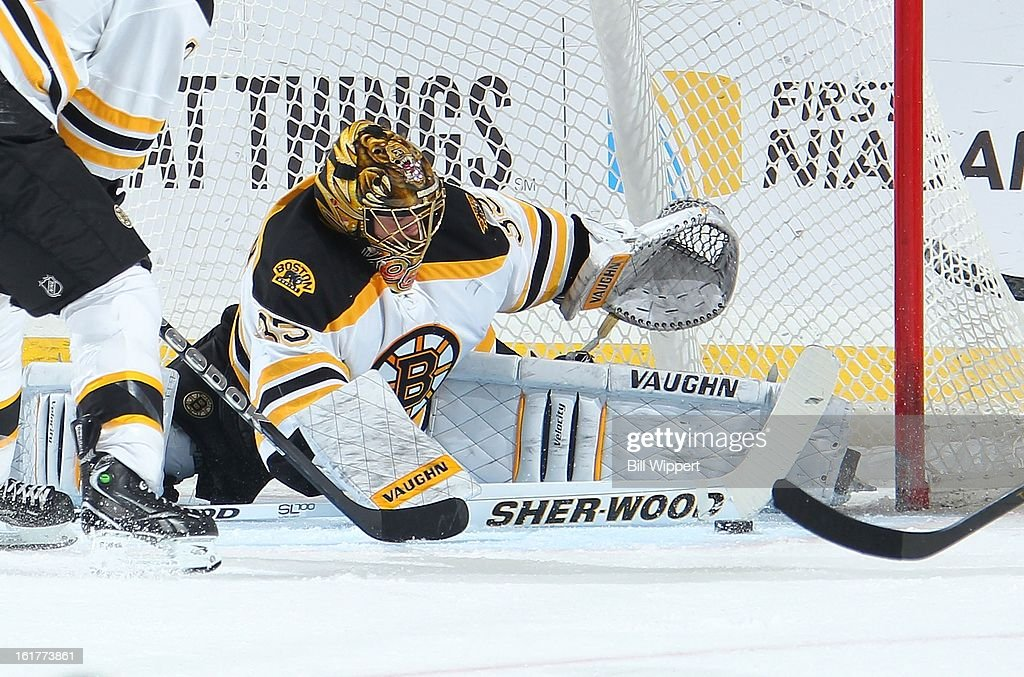 <a gi-track='captionPersonalityLinkClicked' href=/galleries/search?phrase=Anton+Khudobin&family=editorial&specificpeople=722106 ng-click='$event.stopPropagation()'>Anton Khudobin</a> #35 of the Boston Bruins sprawls to make a split save against the Buffalo Sabres on February 15, 2013 at the First Niagara Center in Buffalo, New York.