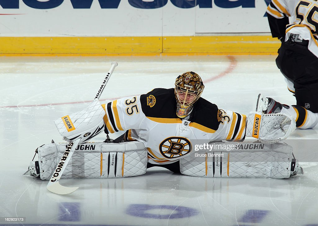 <a gi-track='captionPersonalityLinkClicked' href=/galleries/search?phrase=Anton+Khudobin&family=editorial&specificpeople=722106 ng-click='$event.stopPropagation()'>Anton Khudobin</a> #35 of the Boston Bruins stretches in warmups prior to the game against the New York Islanders at the Nassau Veterans Memorial Coliseum on February 28, 2013 in Uniondale, New York.