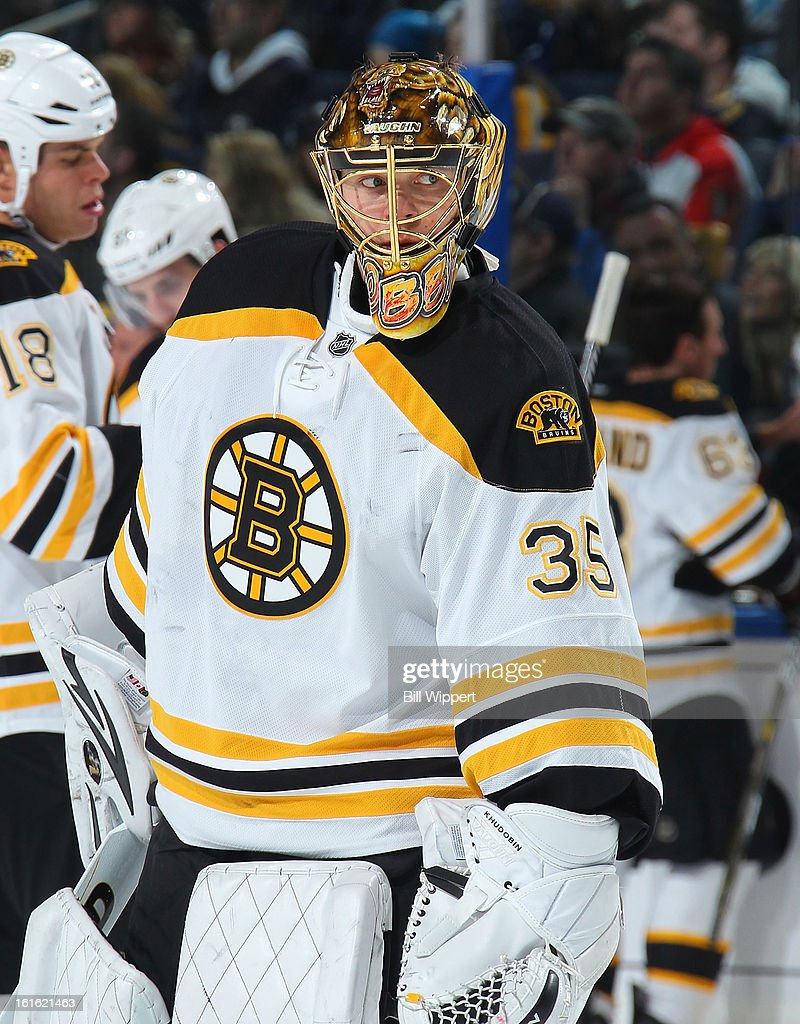 Anton Khudobin #35 of the Boston Bruins takes a break as he tends goal against the Buffalo Sabres on February 10, 2013 at the First Niagara Center in Buffalo, New York.