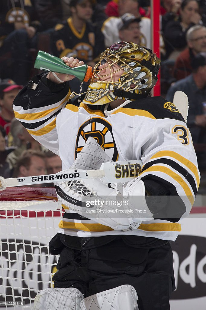 Anton Khudobin #35 of the Boston Bruins takes a drink during a stoppage in play in an NHL game against the Ottawa Senators at Scotiabank Place on April 5, 2012 in Ottawa, Ontario, Canada.