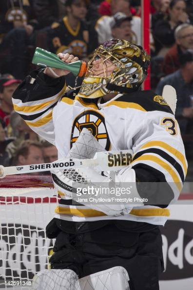 Anton Khudobin of the Boston Bruins takes a drink during a stoppage in play in an NHL game against the Ottawa Senators at Scotiabank Place on April 5...